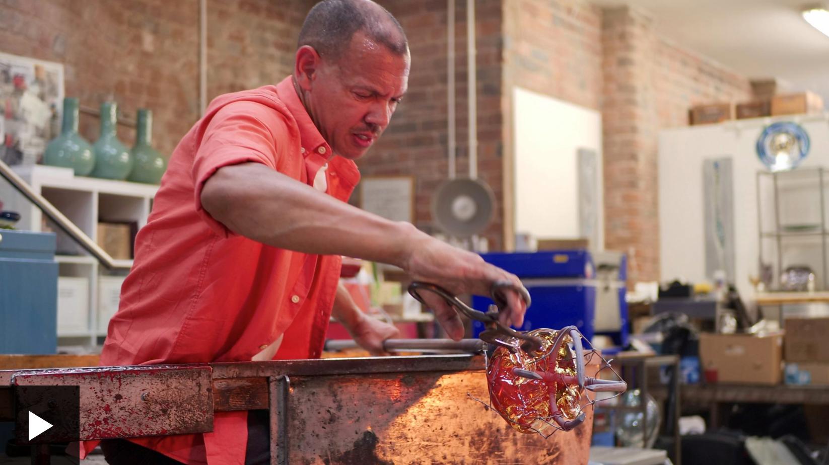 artist chris day making blown glass sculpture in workshop
