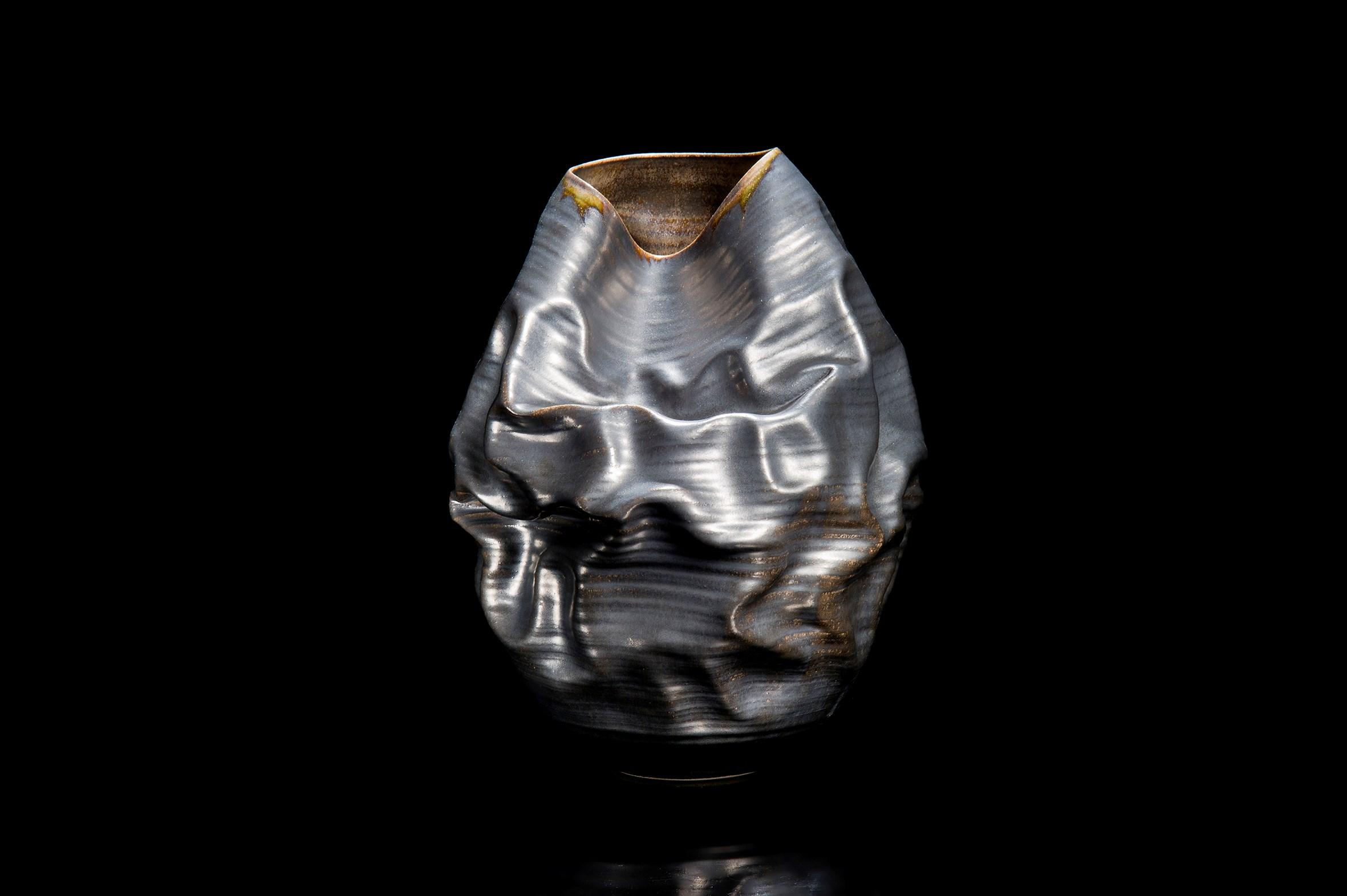 crumpled black art ceramic vase art sculpture Nicholas Arroyave-Portela