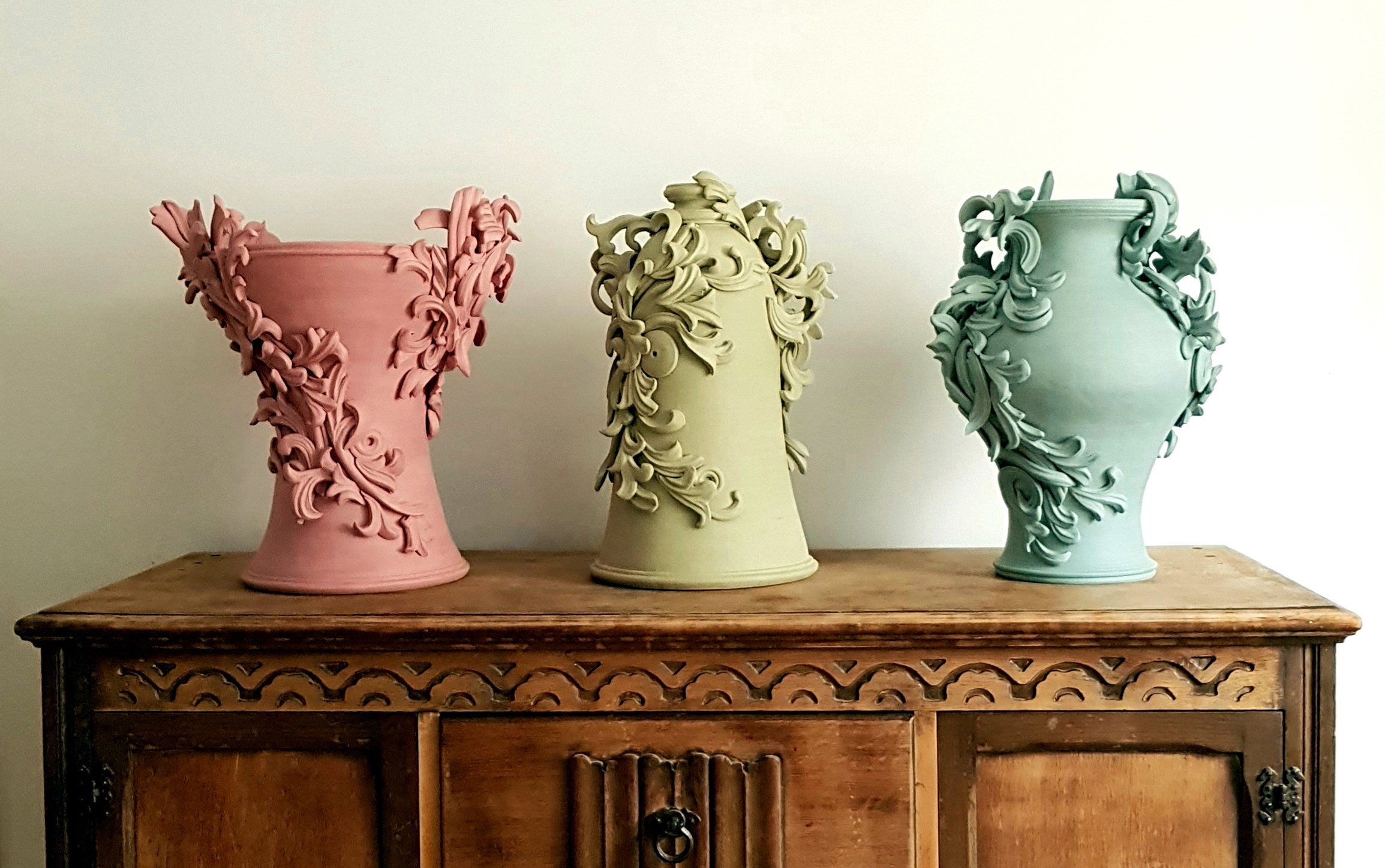clay vase coloured stoneware sculptures in pink, yellow and turquoise