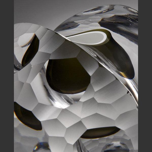 modern minimalist glass artwork in light grey with rock like quality