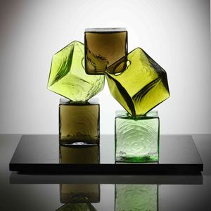 artwork of cubed glass pieces in green and brown colours on black rectangular base
