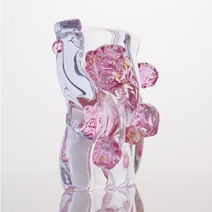 abstract shaped glass sculpture in white and pink