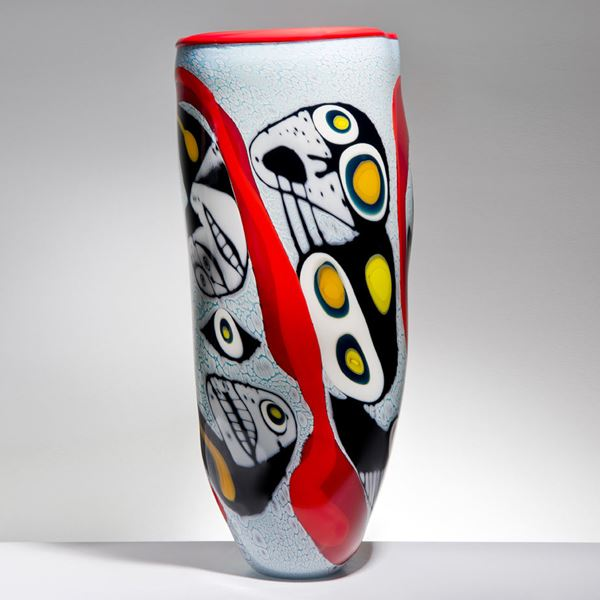 tall art glass vase with abstract faces painted on exterior in white red yellow and black