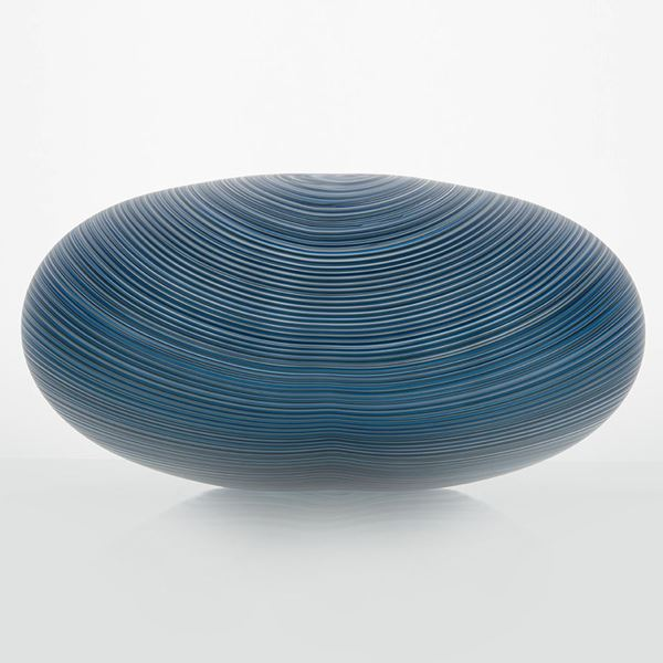 rounded oval glass vessel sculpture with fine lined pattern in blue and grey