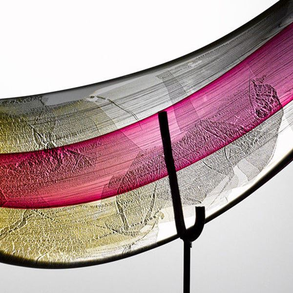 hand blown art glass leaf shape with bright colours on black steel base