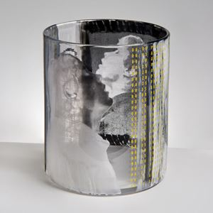 sculpted clear glass tumbler sculpture adorned with the face of a young boy