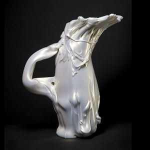 abstract shaped glass sculpture in pearly white of a pitcher
