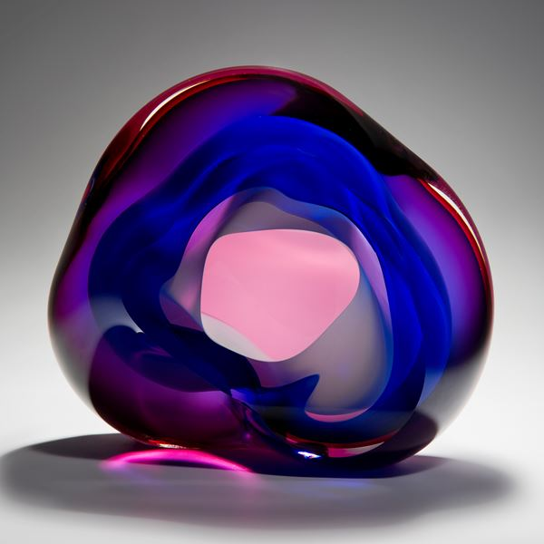 modern vug shaped abstract art glass sculpture in neon pink and dark blue