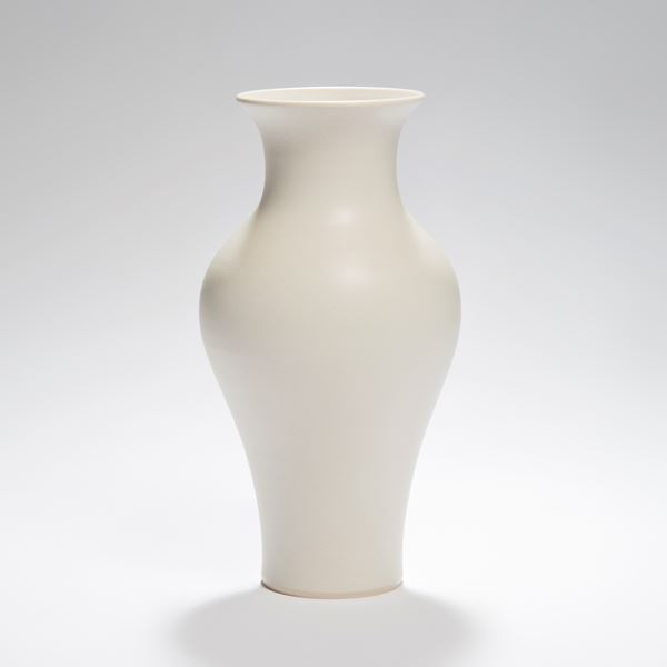 white vase ornament sculpture with wider upper mid section