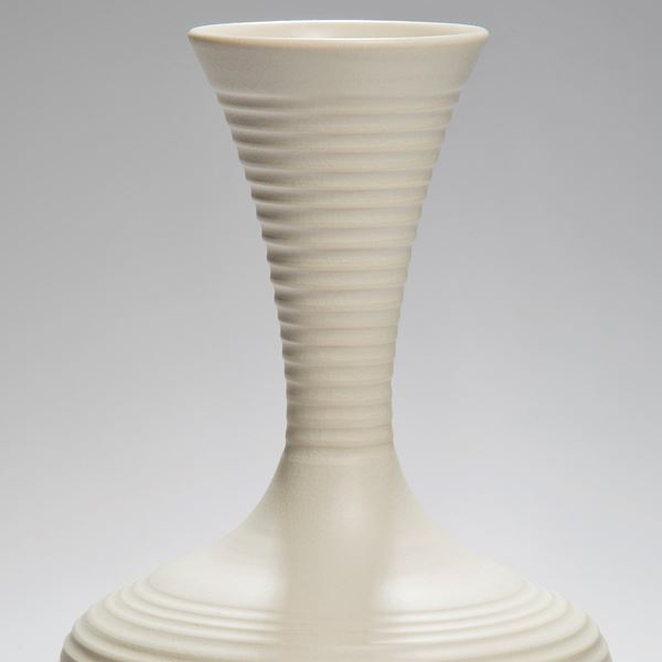 large ridged porcelain vase sculpture in cream