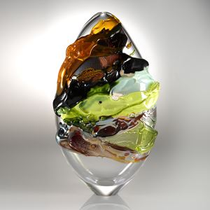 decorative oval shaped glass art sculpture with graffiti coloured exterior