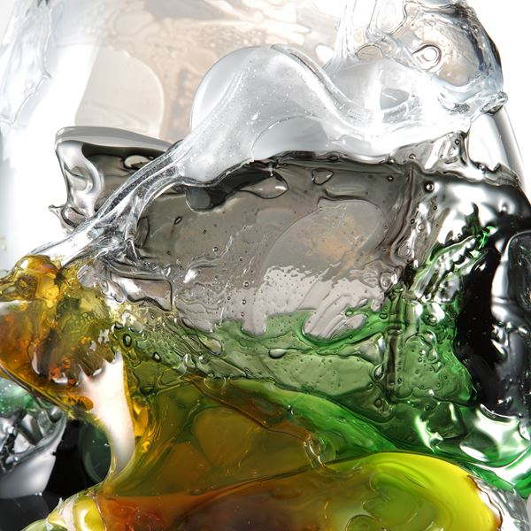 sculpted clear glass decorative art piece with dark green yellow and orange splashes