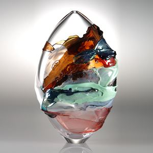 oval shaped blown clear glass vessel with splashes of dark orange light green and pink colour