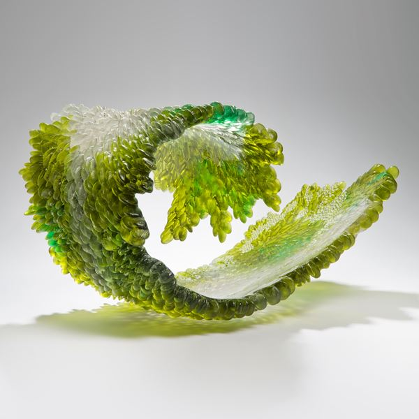 modern art glass sculpture of curled leaf in green