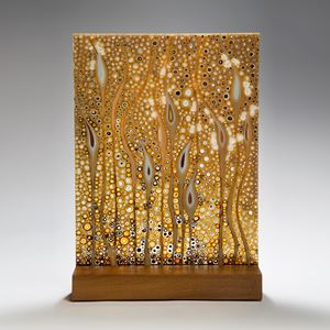 large fused glass art panel of flowers in gold