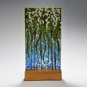 fused glass panel artwork in green and blue on wood base
