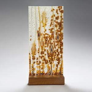fused glass panel inspired by nature with walnut base