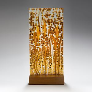 fused glass art panel in autumnal colours on wood block
