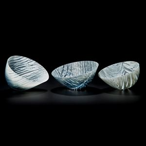 three art glass bowl sculptures in white with black stripes