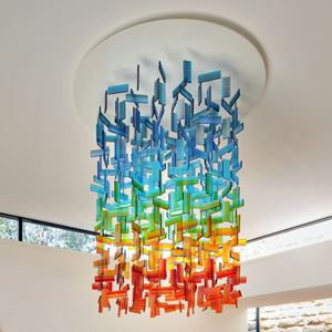 hanging glass installation for interiors made from a large number of rectangular shards in blue green orange and red