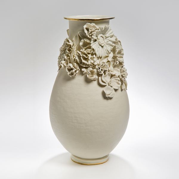 sculpted white medium sized porcelain vase with flower decoration
