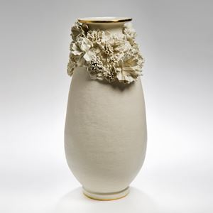 tall ceramic vase in white with flower decoration