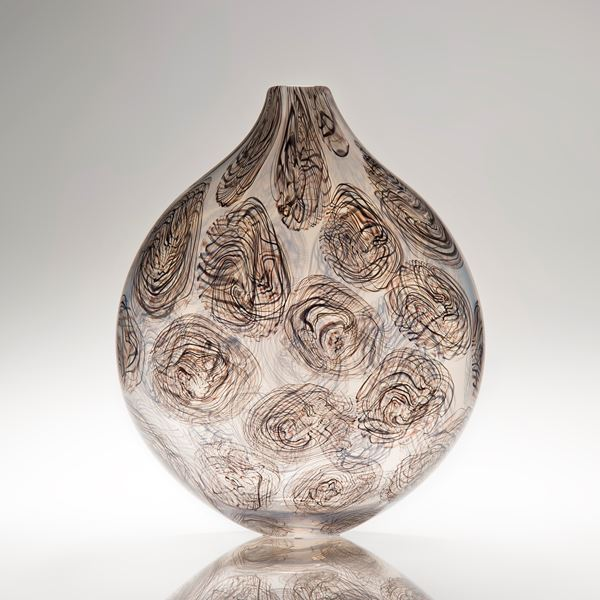 sculpted glass centrepiece vessel in light grey and brown with abstract circular patterns