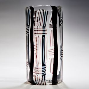 tall rounded and minimalist art glass sculpture in clear glass with black red and white line pattern