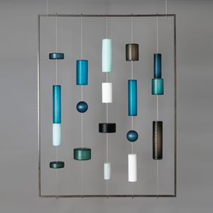 modern glass wall art with pieces held by wire on hollow steel frame