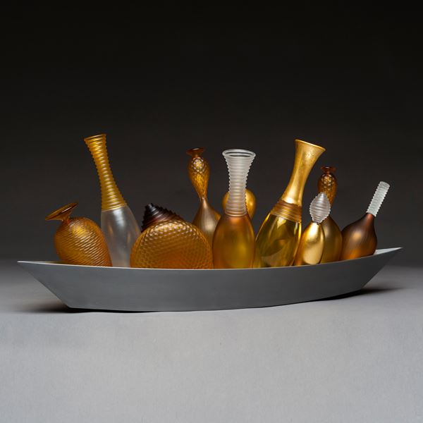 artwork of miniature amber glass vases in long silver tray
