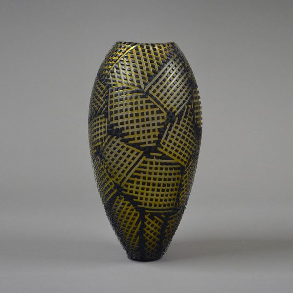tall glass vase sculpture in black with gold checked patterns