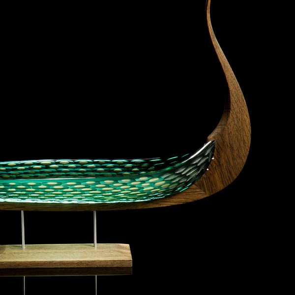 wood and glass sculpture of viking ship in green and brown