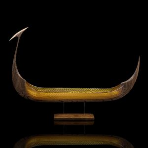 model of viking ship in gold glass and wood