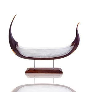 sculpture of viking longboat made from wood and white glass