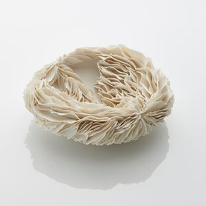 white porcelain art sculpture of flat bowl with feathered appearance