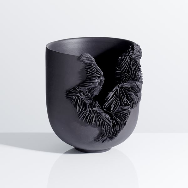 porcelain art sculpture of bowl with frayed open end in black
