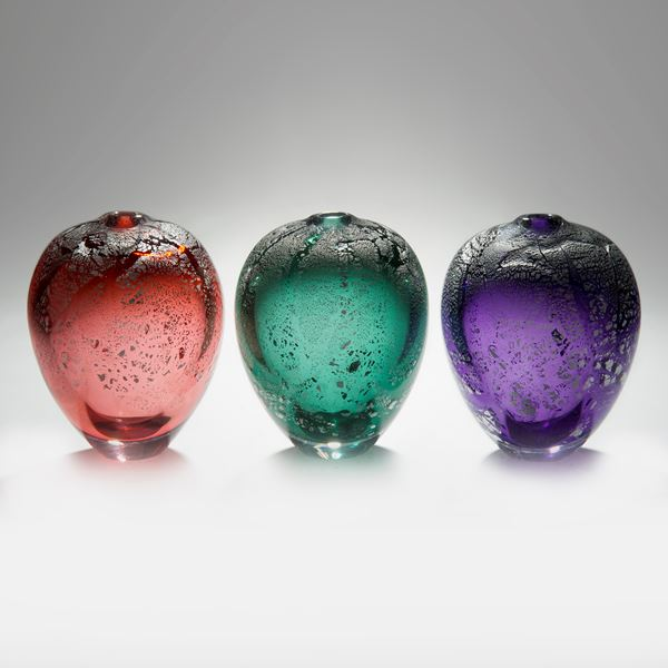 colourful apple shaped glass sculptures with silver speckles