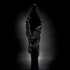 glass artwork of grey cloak on black model