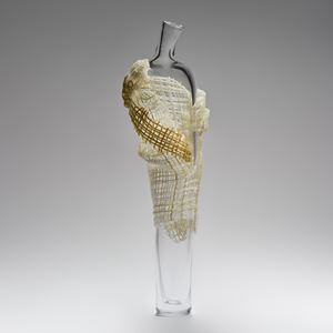 tall abstract blown glass sculpture of vase resembling cloaked figure