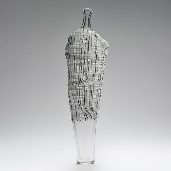 tall contemporary art-glass sculpture of vase with cane cloak resembling human form