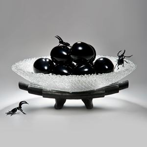 modern art-glass sculpture of bowl with peaches on cermaic base with glass beetles