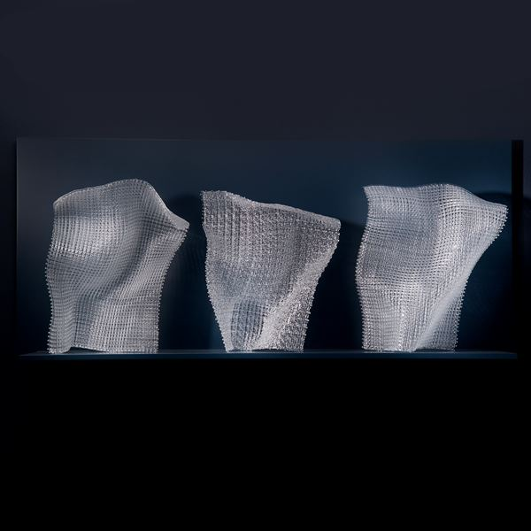 layered and fused modern art glass sculpture resembling cloth stood upright