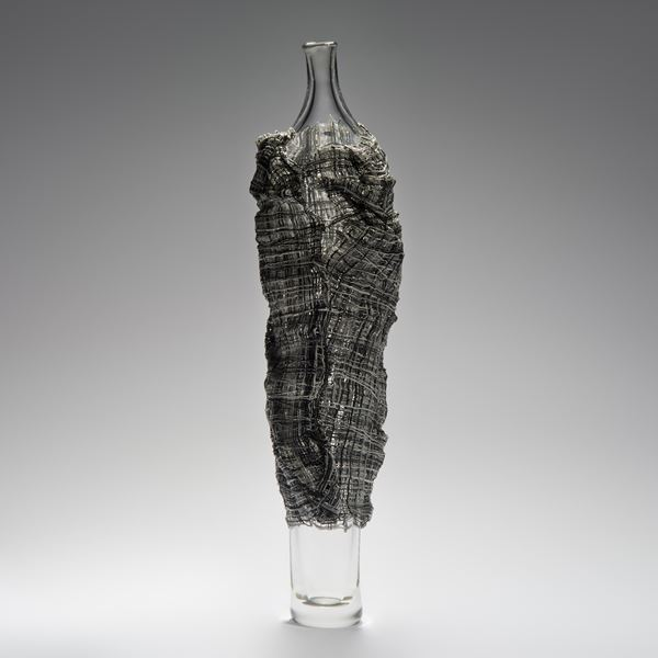tall glass vase sculpted art work wrapped in dark grey glass cane cloak