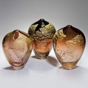 trio of blown art glass sculptural vases in amber with gold leaf-shaped speckles on exterior