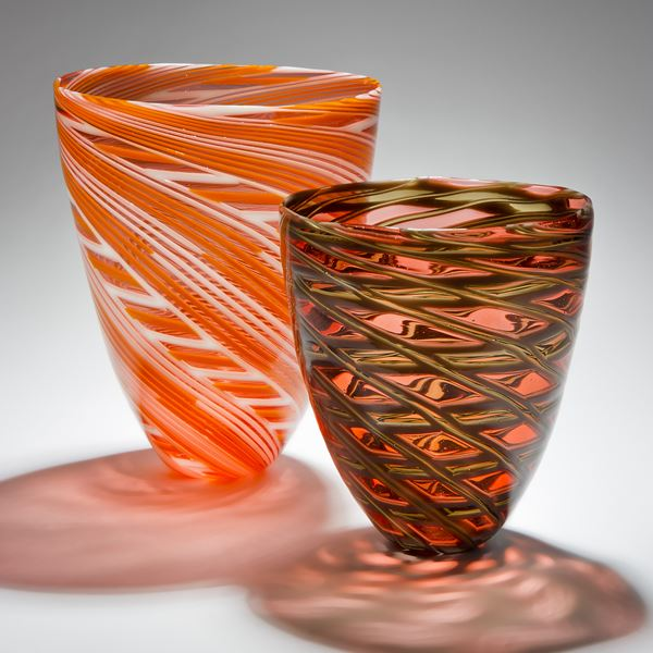 collection of free-blown art-glass short vases in orange pink and grey shades