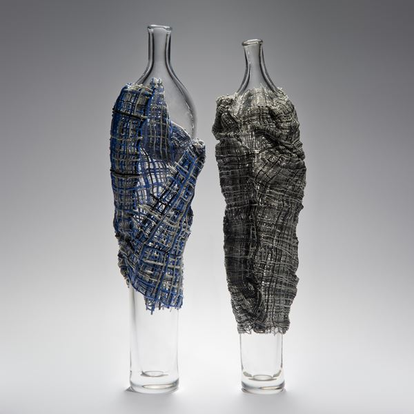 tall glass vase sculpted artwork wrapped in checked cloak made from glass cane