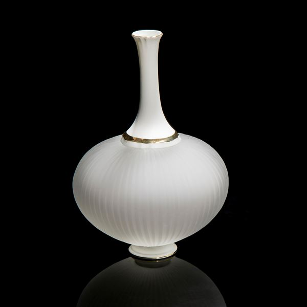 white glass and ceramic sculpture with wide base and long neck