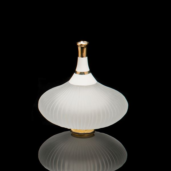 glass and ceramic art sculpture of a teapot in white and gold