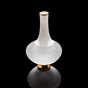 sculpted vessel with wide white glass base and long white porcelain neck on gold base