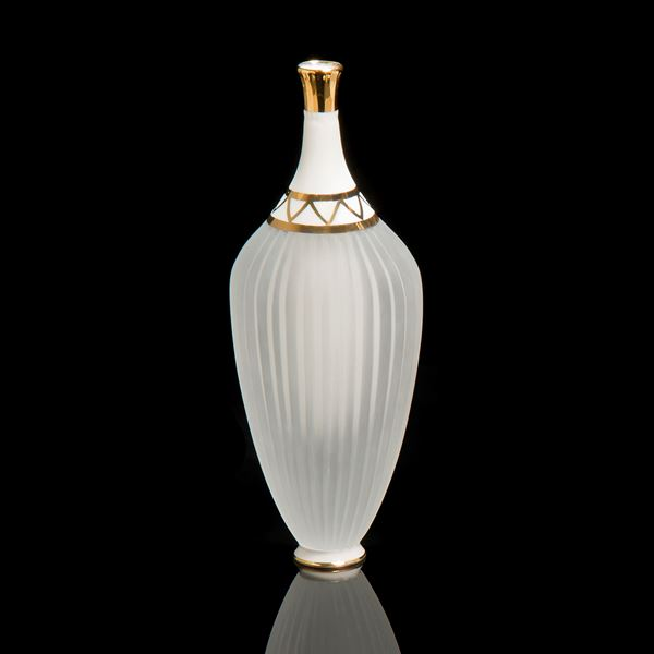 tall crystal glass and white porcelain art sculpture with gold top and trim